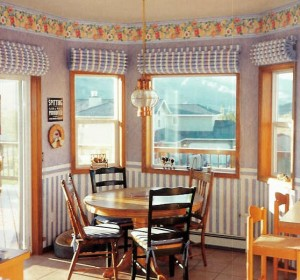 Custom Warm Window insultated shades in kitchen nook by Cozy Curtains
